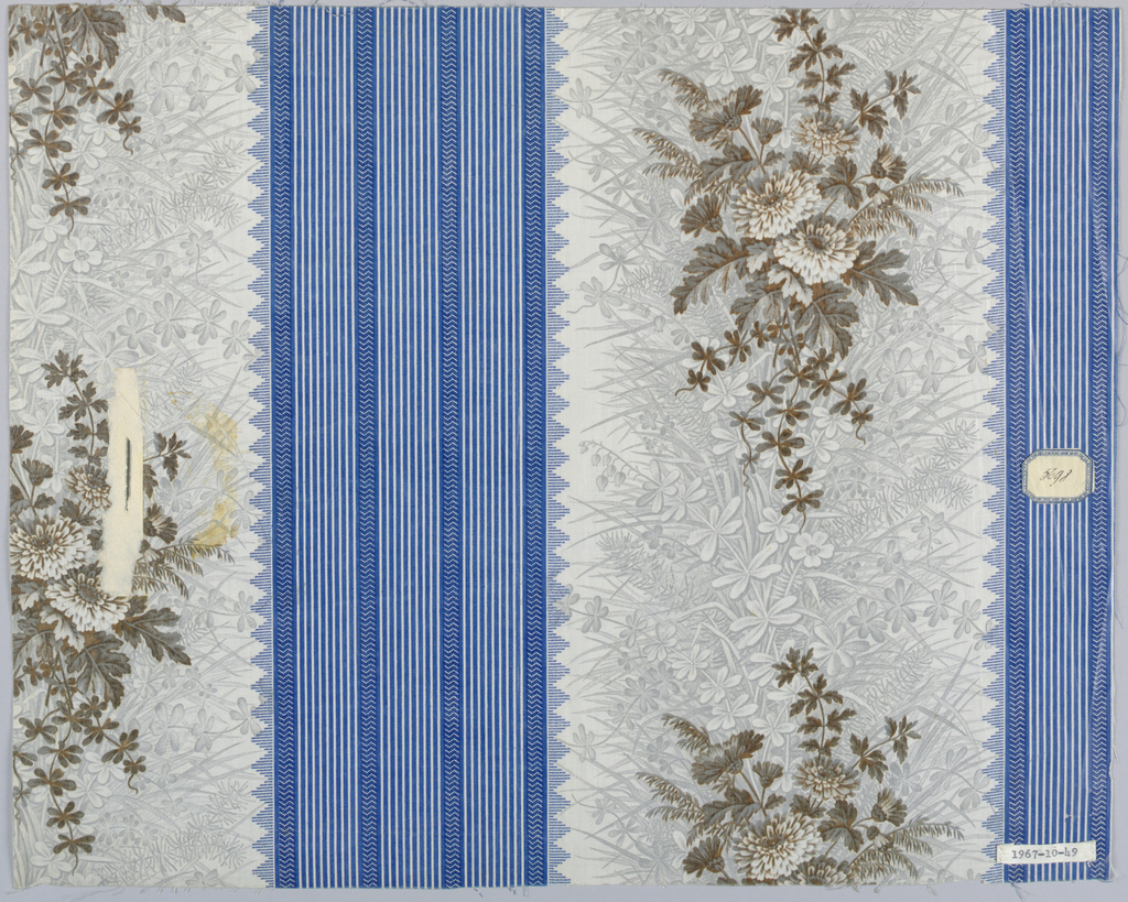 Ground elaborately decorated with grouped stripes in strong blue, alternating with broad stripe, the ground of which is printed in elaborate foliage pattern of wild flowers in grey. This is over-printed with flower clusters, asters, in grey-green, white and dull rose shadows, probably by block.