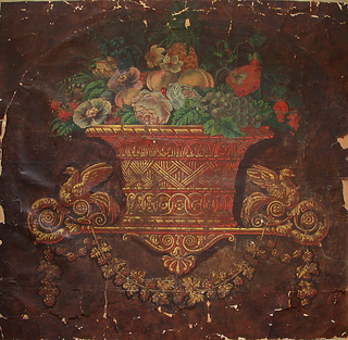 Large-scale basket full of flowers and fruit, including poppies, peaches, grapes and pineapple. The basket sits on a bracket from which hangs a grape vine swag. Printed on deep brown ground.