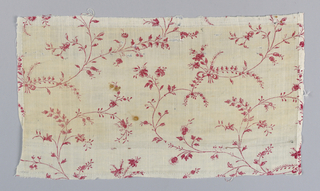 Fragment printed in red on a white ground in a smale-scale floral design.