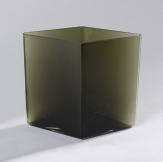 Tall diamond shaped green-toned body of transparent glass.