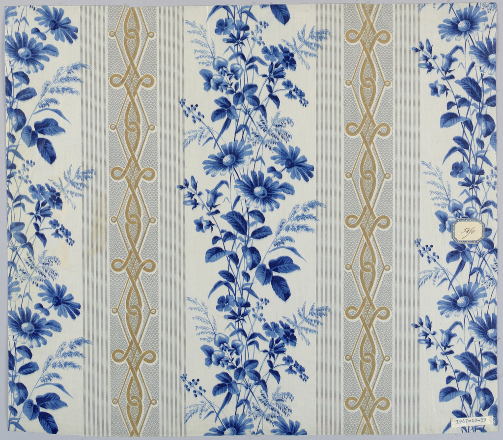 """Two pieces, same design, different colors. A) White ground with broad stripes made of pin stripes of minute bars in rose color, centre area in minute zig-zag with elongated interlace in brown; in white area, sprays of field flowers in shades of red, block-printed or surface roller. Ground probably """"molette."""" B) Same design in blue. Glazed."""