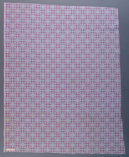 Length of printed cotton patterned by rows of diamond shapes in two alternating colors. Larger squares in a staggered repeat appear over diamond shapes. Colorway is pink and white.
