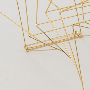 This brooch is composed of compounded cube shapes toppling over each other in a gentle curve that echos the shape of the shoulder--where it is meant to be worn.