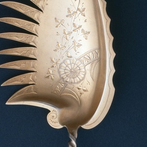 Wide concave blade with feather-like serated edge and engraved floral ornament; handle in form of twisted stem with ball finial.