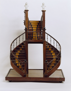 Model of a curved double staircase reaching a landing and continuing up as a single stair; steps and risers inlaid in contrasting wood to emulate carpet; busts of Francois-Marie Arouet, called Voltaire (1694-1778), and Jean-Jacques Rousseau (1712-1778) made of Sèvres biscuit porcelain on newel posts at top.