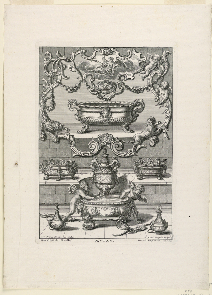 A large frame on a wall consisting of scrolls, putti, a lion, a mascaron, fruit and flower festoons and a lobster. Inside the frame is a large tureen with lion's feet and a woman's face at center. Below the frame, there are smaller tureens at left and right; at center a fountain in the shape of an urn with two putti playing.