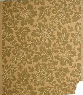 """On mustard ground, symmetrical repeating pattern in brown with light yellow accents: stylized foliage and flower forms. Printed in margin: """"1351""""."""