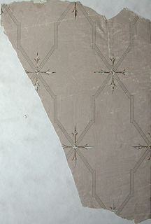 Irregularly shaped portion of paper with stepped lattice framework and conventional leaf motif at points of intersection. Printed in browns and gray on neutral pink ground.