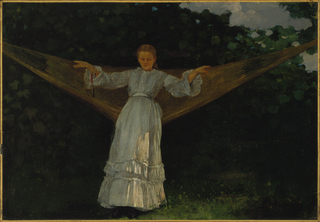 Horizontal view of a young woman in white flounce dress standing in center; leaning against a hammock swung from supports beyond the right and left edges of picture; resting her arms on farther edges of hammock and looking down.  A fan hangs from a cord around her right wrist.