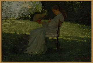 Horizontal view of woman in profile, holding  a fan in her right hand and sitting in a folding chair on a shaded spot of lawn;  tree foliage in background.  She gazes down on a butterfly resting  on the back of her left hand; another butterfly flits above the lawn  near the left edge of picture.