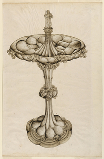 The silver centerpiece is bossed and decorated with croquets; from the center of the cup rises a pedestal on which a man stands holding two spears; two coats of arms are standing between his legs, showing three stars, a cracknel and a bird.