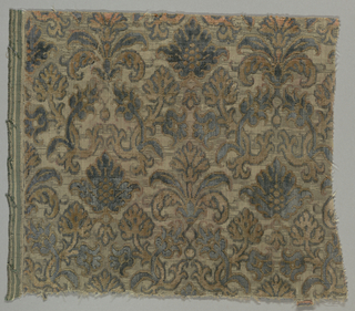 Fragment of gray-blue and rose cut and uncut velvet on a ground shot with metallic thread in a small-scale pattern of palmettes and flowers.