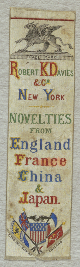 "White ribbon with a griffin on a plinth with the word ""Trademark"" inscribed on it. Below: ""Robert K. Davies & Co. New York Novelties from England, France, China & Japan."" American shield flag with an eagle is surrounded by the flags of each of the four nations."