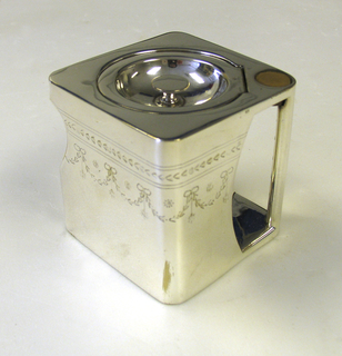 "Square ""cube"" body, flat base and top. Flush hinged recessed circular cover set diagonally on top. Concave section at corner forms pouring spout. Opposite corner recessed to create handle aperture;handle vertical; wooden thumbrest inset at top; bright-cut engraved swags around body near top."
