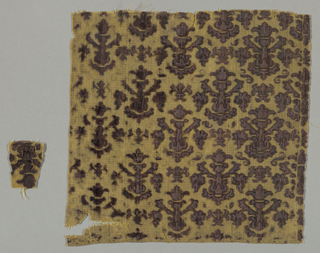 Candelabra motif in offset rows in deep mauve on natural.