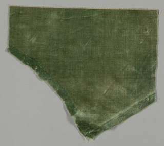 Fragment of solid cut green velvet. Cotton backing.