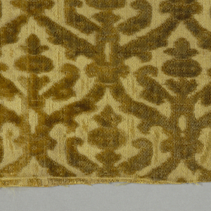Brown silk velvet, cut and uncut, on yellow ground; palmette in ogival frame.