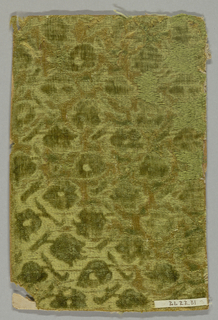 Fragment of green cut and uncut velvet on self-colored satin ground. Design of tiny flowering branches alternately pointing up and down.