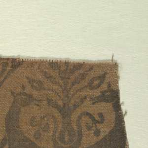 Fragment of printed linen with teardrop-shaped medallions containing pairs of addorsed, regardant gazelles and plant forms in blue on natural.