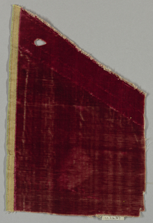 Fragment of solid red cut velvet.