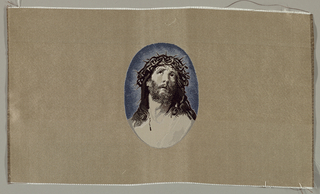 Head of Christ with a crown of thorns in brown and white against blue within an oval. Oval on beige background.