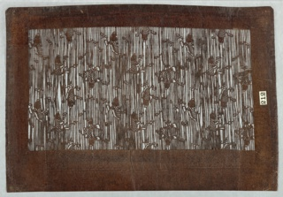 Flying carp swimming among vertical stripes resembling a ferocious stream. Alternating rows of carp appear in alternating directions. Silk threads have been added horizontally to support the stencil structure.