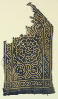 Pointed rectangle, probably originally used as portion of ornamental border for large cloth or hanging.  Design of stylized lotus blossom and foliage with vine border, resist-printed in white on dark blue ground.