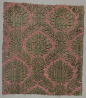 Fragment of cut dark green velvet pile in a stylized symmetrically placed repeated floral and foliated motif against a red ground.