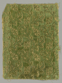 Green cut and uncut velvet in a diagonal arrangement of stylized leaves.