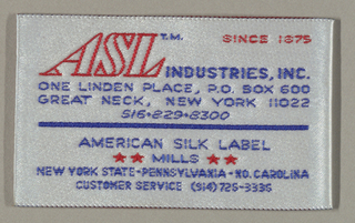 "Jacquard woven label in red and blue on white, folded so one side reads: ""ASL INDUSTRIES TM. INC./SINCE 1875/ONE LINDEN PLACE, P.O.BOX 600/GREAT NECK, NEW YORK 11022/516-829-8300/AMERICAN SILK LABEL/MILLS/NEW YORK- PENNSYLVANIA-NO.CAROLINA/CUSTOMER SERVICE (914)726-3336"" Other side reads: ""MICHAEL STERN"""