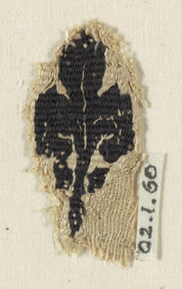 Small fragment showing a leaf with elaborate volutes at each side.