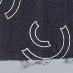 Silk textile  with pattern of white curves against a black ground.