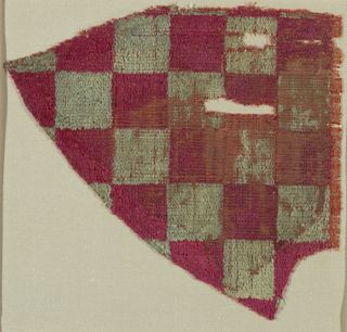 Fragment in a checkerboard pattern of red and faded green squares.