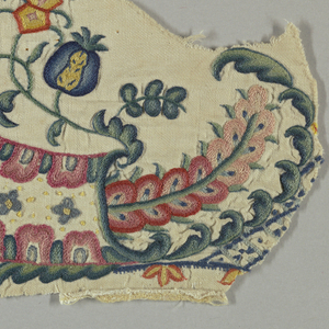 Fragments showing formal floral forms in multicolored wool on linen.