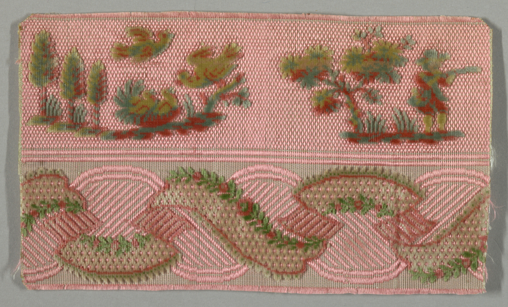 "Fragment of ""velours miniatures"" divided in half with the top section showing vignettes of trees, birds and a single hunter with a gun. The bottom section has an entwined ribbon garland decorated with sprigs. Fragment is mainly pink with red, blue and greyish-green."