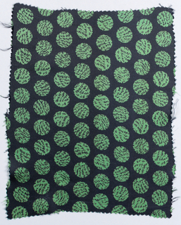 Small sample of dark blue silk printed with mottled green dots.