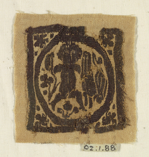 A square panel with a hunting figure holding a rabbit aloft in one hand and a weapon in the other.