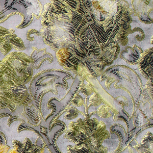 Fragment of matelasse, warp-printed and hand-cut, showing all-over quilted floral pattern.