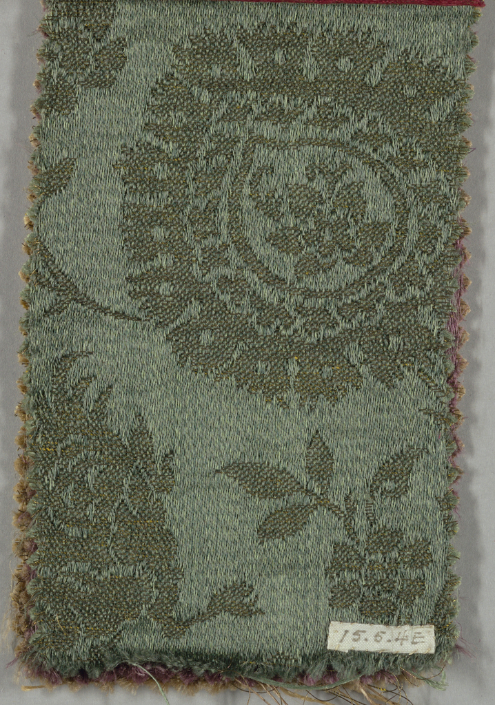 Reproduction textile samples adopted from a Lucchese design in the collection of the Cooper Union Museum. Samples (b/g) of black, blue, green, purple, and taupe with gold weft with a pattern of serpentine branches with ogive blossoms and Chinese-inspired monsters and senmurvs between serpentines.