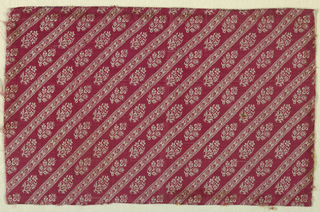 Fragment of red and white striped floral pattern is arranged diagonally.