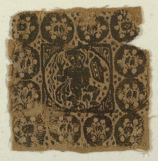 Square tapestry-woven fragment.  Monochrome type, dark purple-brown wool and undyed linen.  A roundel within the square shows a warrior wearing a mantle and carrying a sheild.  The border contains ten ornamental medallions.