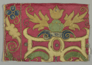 Applique of woven silks colored yellow, green and blue on a red satin ground. Fragment was part of a larger piece.
