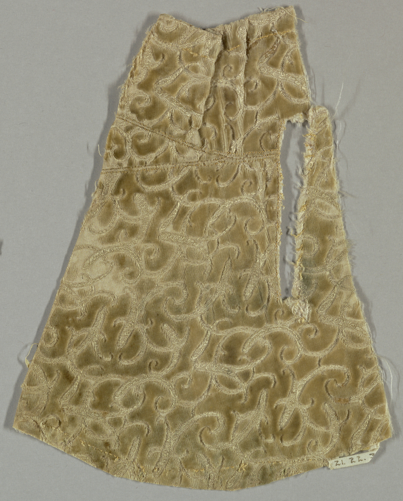 Fragment of cream-colored velvet. Small allover design in fancy cloth ground of self-color. Interstices filled with cut velvet. Intricate pattern of fine curving lines.