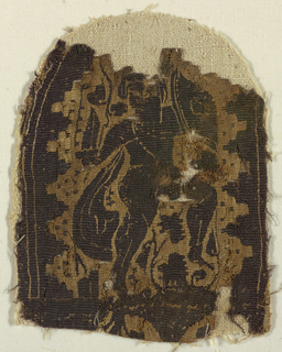 Monochrome type, dark brown wool and undyed linen.  A cloaked warrior with a sword and shield is seen in three-quarter view stepping up to the right. The figure is framed within an arch against a field of vegetal motifs and regularly spaced dots.  Below this figure two partial roundels or arches can be seen.