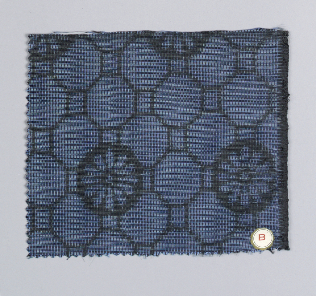 Octagon and square grid with rosettes in blue and black.