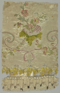 Whtie satin ornamented with embroidery in colored silks and chenille and needlemade net; design of scrollign lines, flowers and flowering vines. Selvage: green stripe.