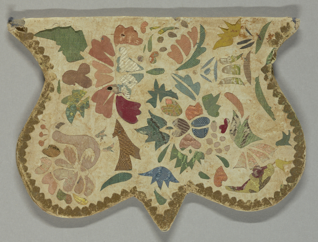 Cover is ornamented by bits of brocade showing three openings in paper, which has been cut out in floral and bird designs. Edges of cover are shaped and bound with gilt paper.