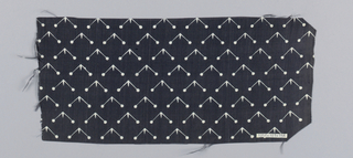 Silk textile printed with pattern of white right angles with circles at each end against a black ground.