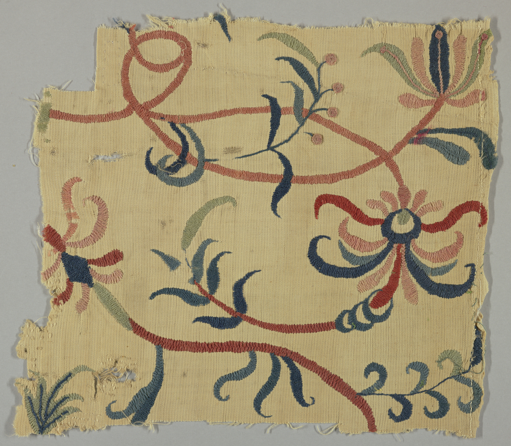 Fragment of embroidery with linear flowing vine pattern worked in colored wools on natural colored cotton; pale green, pink, soft red and shades of blue worked in satin, stem and basket stitches.