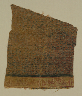 Wedge-shaped fragment of dark green with pattern in dark yellow-gold. Horizontal band at bottom in cream-color, light red and tan. Design has a small-scale pattern of eight-pointed star framing petals, alternating with rosette in a circle. Narrow green line about band. Pattern in band of small confronted lions and Kufic script.
